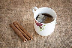 Cup of tea with cinnamon Stock Image