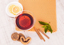 Cup of tea with cinnamon and mint Royalty Free Stock Image
