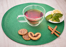 Cup of tea with cinnamon and mint Royalty Free Stock Photos