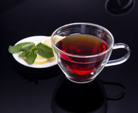 Cup of tea with cinnamon and mint Royalty Free Stock Images
