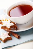 Cup of tea with cinnamon stars for christmas Royalty Free Stock Image