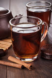 Cup of tea with cinnamon sticks Royalty Free Stock Photography