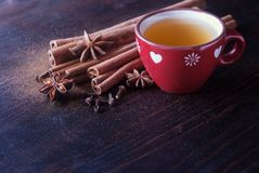 Cup of tea with cinnamon royalty free stock photography