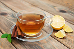 Cup of tea with  cinnamon Stock Photo