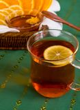 Cup of tea and citruses Stock Photos