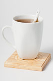 Cup of tea on coaster Royalty Free Stock Images