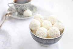 Cup of tea with coconut balls Stock Images