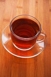 Cup (tea, coffee) against wooden Stock Photography