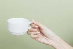 Cup of tea or coffee in hand Royalty Free Stock Photography