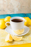 Cup of tea / coffee & lemons Stock Photos