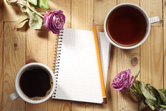 Cup of tea, coffee and notebook Royalty Free Stock Image