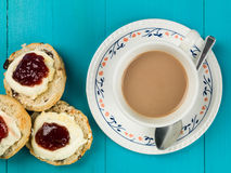 Cup of Tea or Coffee With Scones Clotted Cream and Strawberry Ja Royalty Free Stock Photo