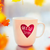 Cup of tea or coffee on window still with autumn falling leaves and text Hello Autumn Royalty Free Stock Images