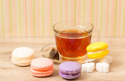 Cup of  tea and colored cakes Royalty Free Stock Photo