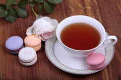 Cup of tea with colorful french macaron Royalty Free Stock Image