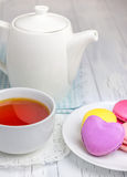 A cup of tea with colorful macarons. A cup of redbush tea with colorful macarons Royalty Free Stock Photos