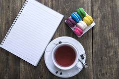 Cup of tea and colorful macaroons Royalty Free Stock Photo