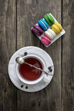Cup of tea and colorful macaroons Royalty Free Stock Image