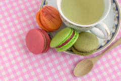 Cup of tea with colorful macaroons Stock Photos