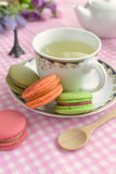 Cup of tea with colorful macaroons Stock Images