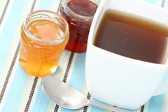 Cup of tea with confiture Royalty Free Stock Photography