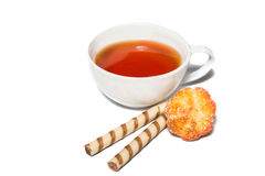 Cup of tea and a coockie on white Stock Photos