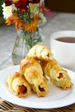 Cup of tea and cookes. With flowers in the background stock photo