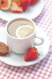 Cup of tea,cookie, fig and strawberries Stock Images