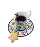 Cup of tea with a cookie in the form of a star Royalty Free Stock Photography
