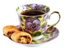 Cup of tea with cookie on saucer Royalty Free Stock Images