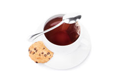 Cup of tea. With cookie and a small spoon isolated on white background Stock Images