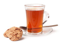 Cup of tea and cookies. Cup of tea and chocolate chip cookies on white background royalty free stock photo