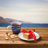 Cup of tea with cookies. Over beautiful view of the sea stock photo