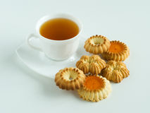 Cup of tea and cookies. Cup of coffee and cookies are on a grey background Royalty Free Stock Image