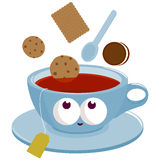 Cup of Tea and cookies dunking into tea Royalty Free Stock Photo