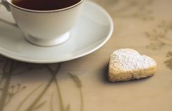 Cup of tea and cookies heart-shaped. Cup of tea and homemade  cookies heart-shaped Stock Photos