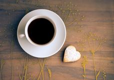 Cup of tea and cookies heart-shaped. Cup of tea and homemade  cookies heart-shaped Stock Images