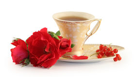 Cup of tea, cookies and rose. Royalty Free Stock Image