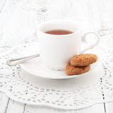 Cup of tea with cookies on served on wooden table. Royalty Free Stock Photo