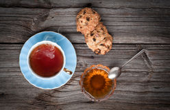 Cup of tea, cookies stack and honey on a wooden Stock Photography