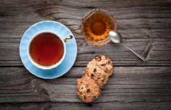 Cup of tea, cookies stack and honey on a wooden Royalty Free Stock Photo