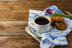Cup of tea and cookies on tea tray Stock Image