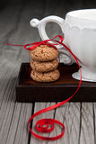 Cup of tea and cookies on wooden background Royalty Free Stock Photo