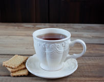 Cup of tea and cookies Stock Images