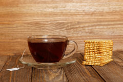 Cup of tea and cookies on wooden table Royalty Free Stock Images