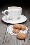 Cup of tea and cookies on wooden tabletop Royalty Free Stock Images
