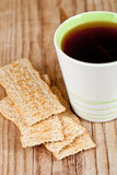 Cup of tea and crackers Stock Image