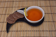 Cup of tea and crackers on wood. Cup of tea and crackers Royalty Free Stock Image
