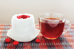 Cup of tea and cream cake with cherries Royalty Free Stock Images
