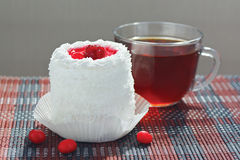 Cup of tea and cream cake with cherries Stock Photography